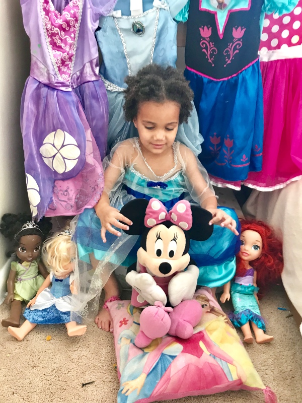 Mixed child holds Minnie Mouse